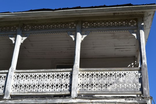 A detail of the intricate balustrade and frieze on the porch.