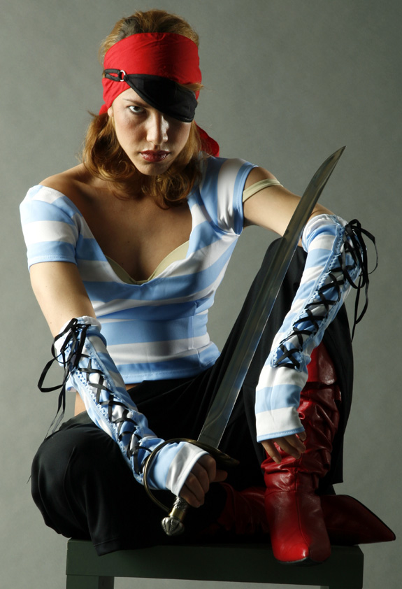 photo reference of a woman dressed as a pirate with a sword and eye-patch