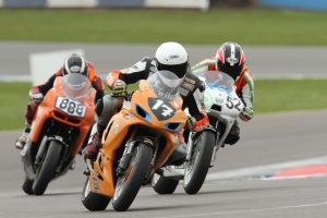 Garf, Alex and Josh fighting into the Final Chicane