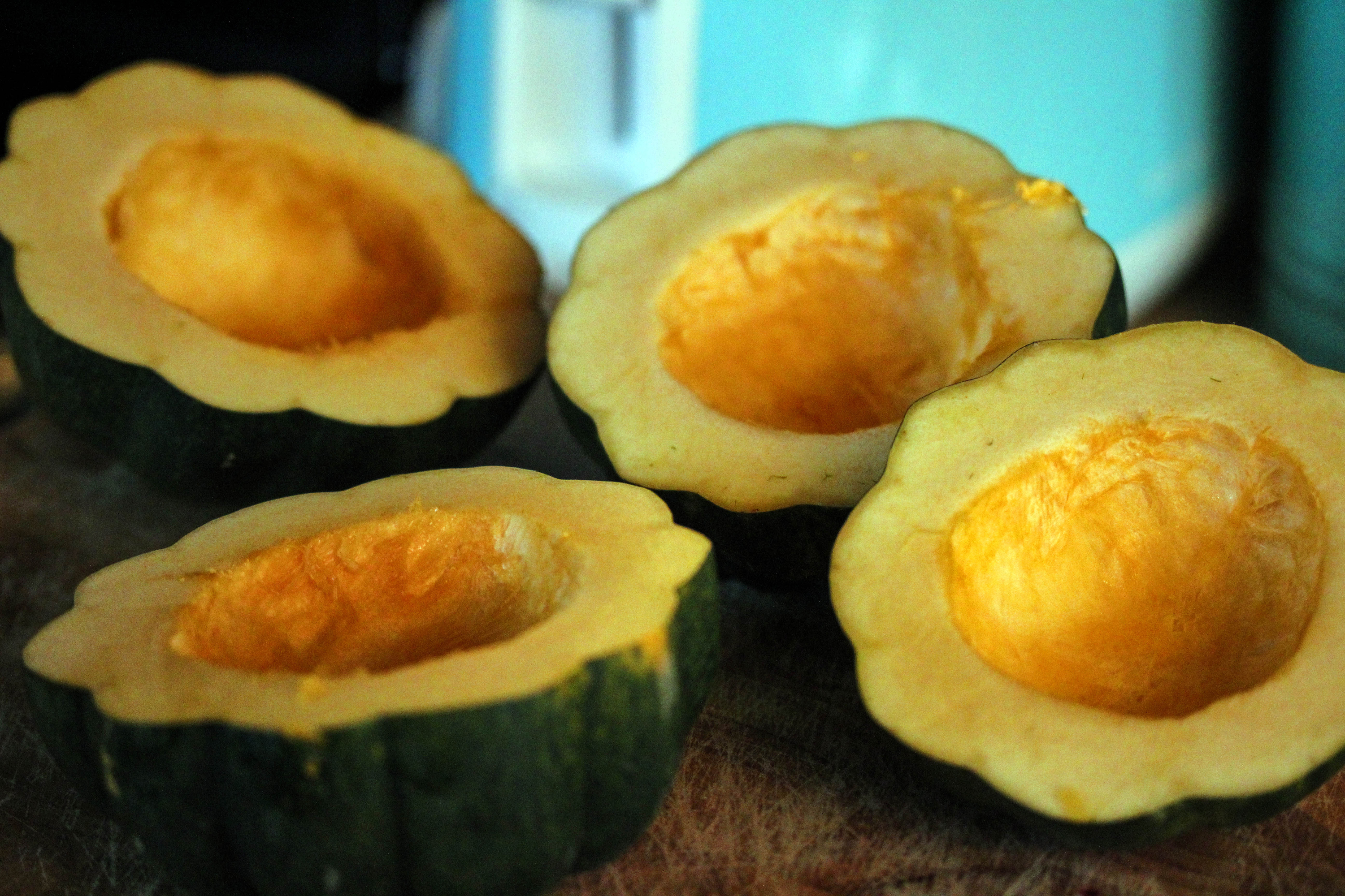 sliced squash for Roasted Acorn Squash with Cranberry Walnut Quinoa