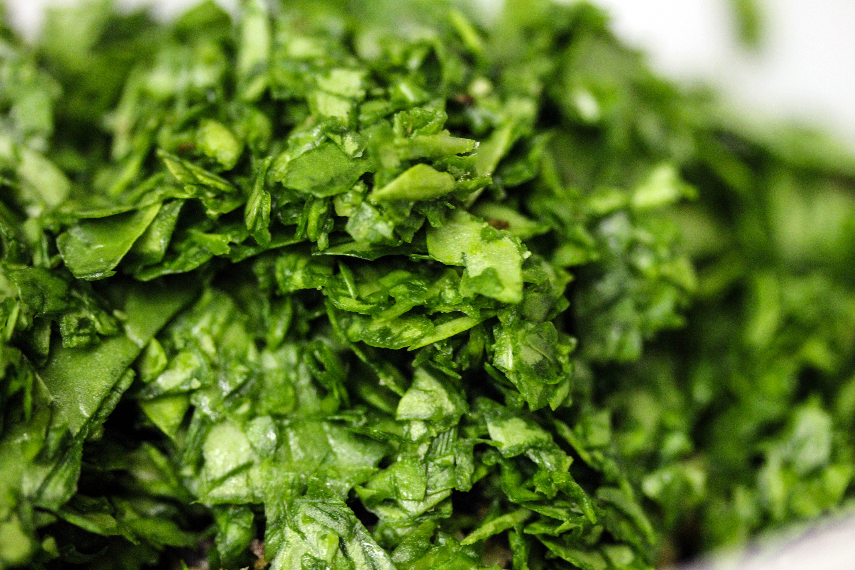 Chop spinach, either with a knife or in a food processor