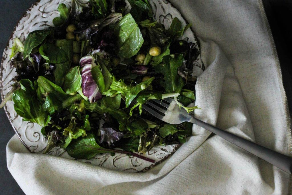 Assemble ingredients for Avocado and Greens Salad with Lemon Mint Dressing