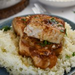 Pork chops on plate with sauce
