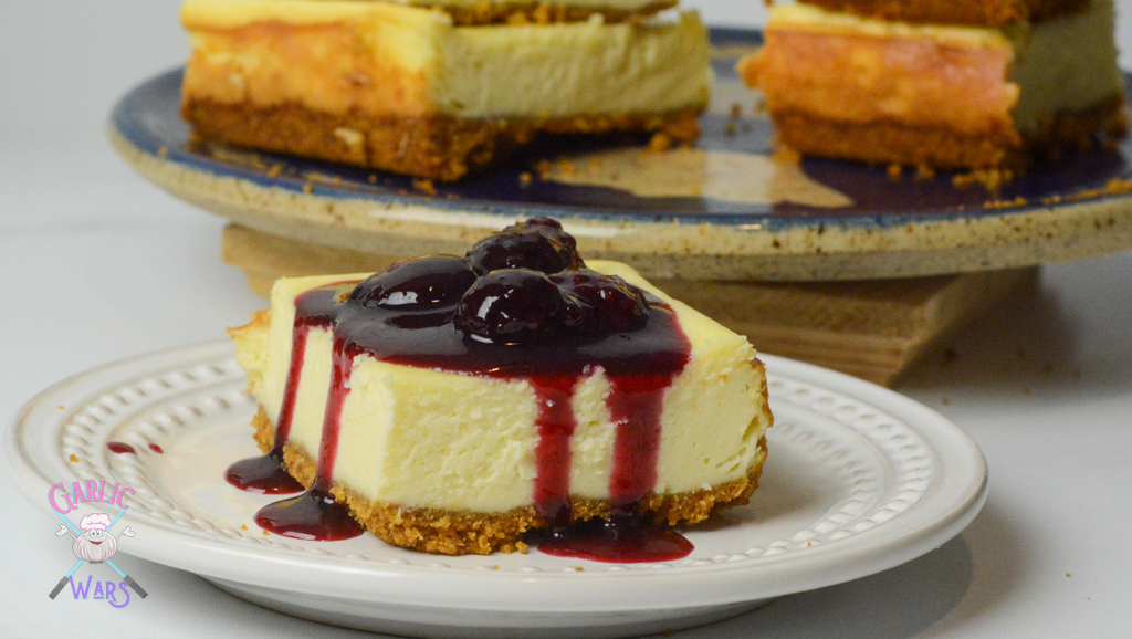 cheesecake bar with sauce running down the sides