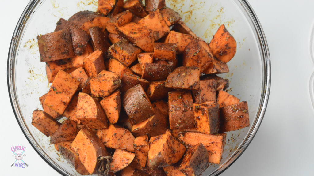Sweet potato home fries tossed in spices before baking.