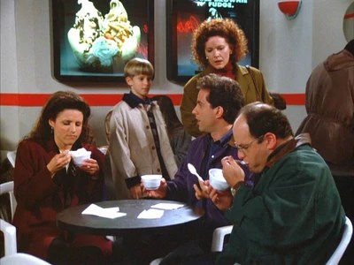 Jerry, Elaine, and George sit in the yogurt shop.