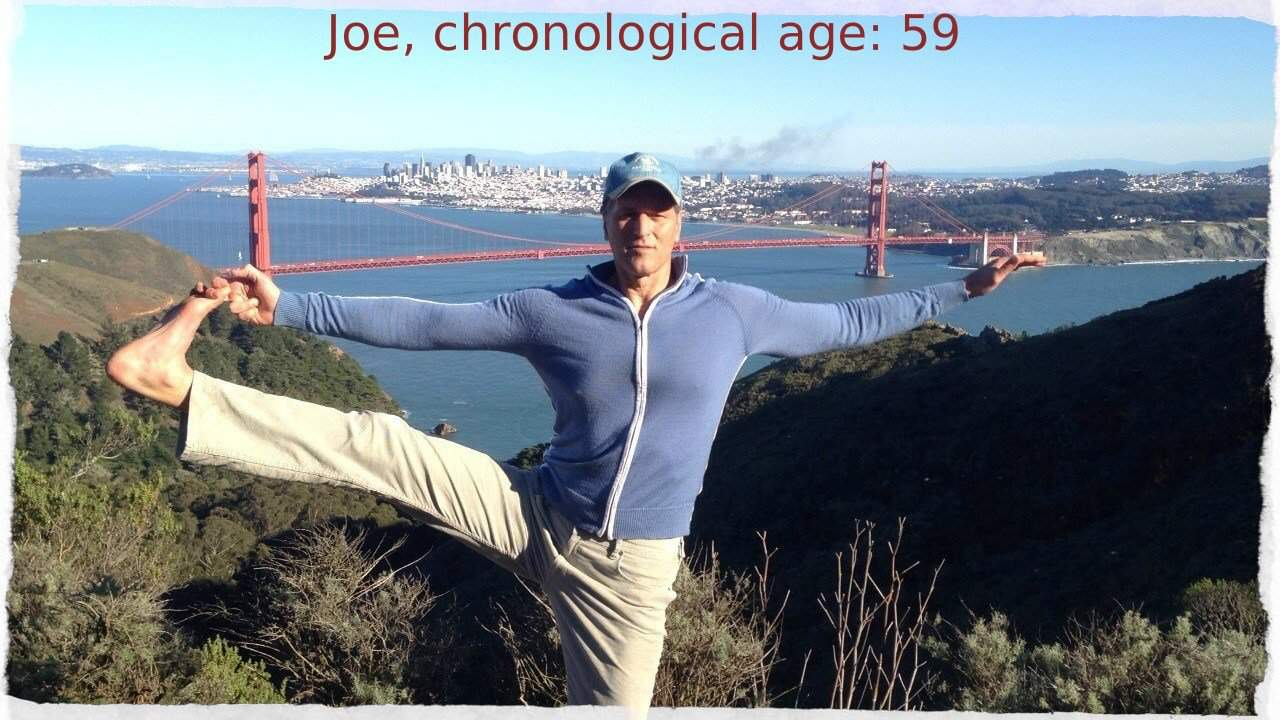 Joe flexes his leg above the Golden Gate Bridge