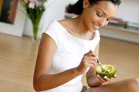 woman eating avocado