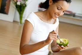 woman eating avocado