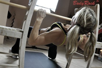 Pull-ups using a bar and chairs
