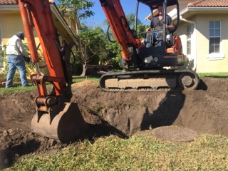 Earthworks and Drainage repair services by Garrett Landscape and Property Management Services.