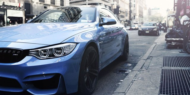 Blue sports car at the curb