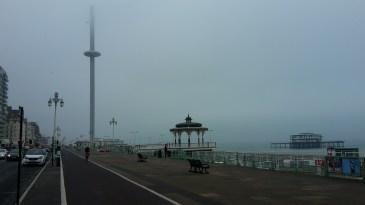 Brighton seafront with the old West pier and the new i360