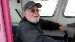 Old man on a boat