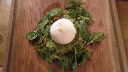 Poached egg and pine nut salad