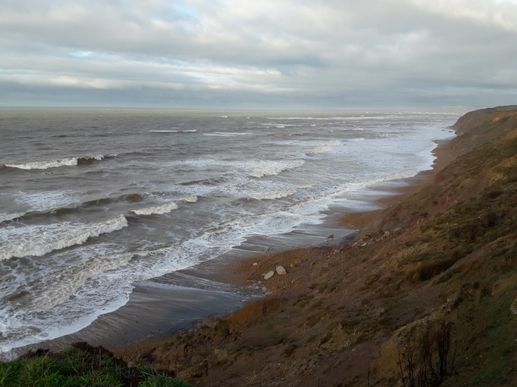 Rough sea and cliffs