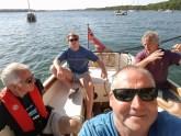 4 men on a boat
