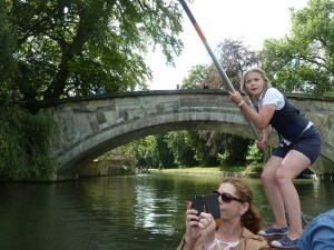 Girl punting on a river