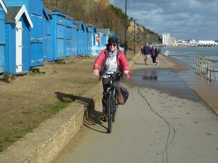 Women cycling along the seafront