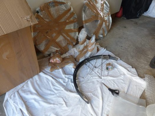 Bicycle racks and wheels wrapped for protection