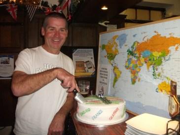 Garry McGivern cutting the cake
