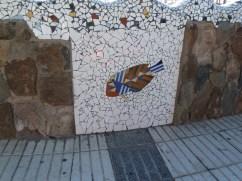Mosaic of a fish on a wall in Puerto De Mogan