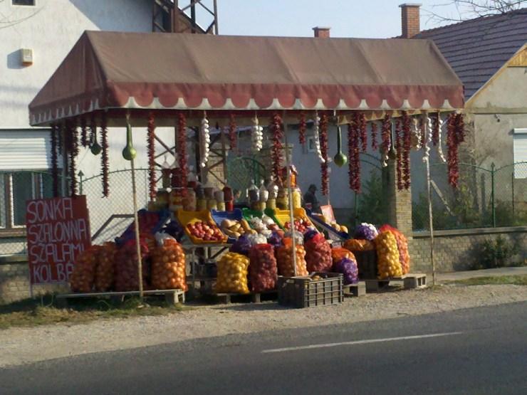 Little market stall outside a house
