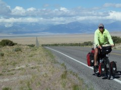 Man on bicycle on a long road