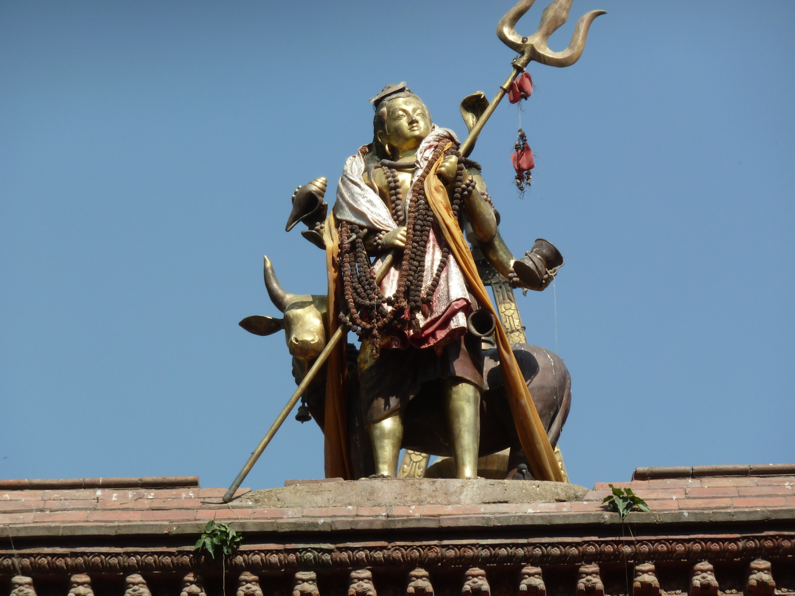 Diety on top of a building in Kathmandu.