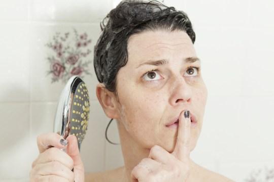 Woman thinking in shower Gary Dumais