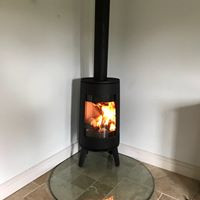 Nordpeis corner wood burning stove with tear drop glass hearth
