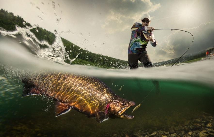 An avid angler battles a ferocious rainbow trout.