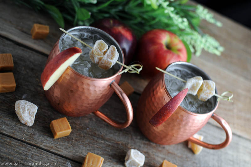 Caramel Apple Moscow Mules are the ultimate fall cocktail, full of fresh apple cider, crisp ginger beer and caramel infused vodka!