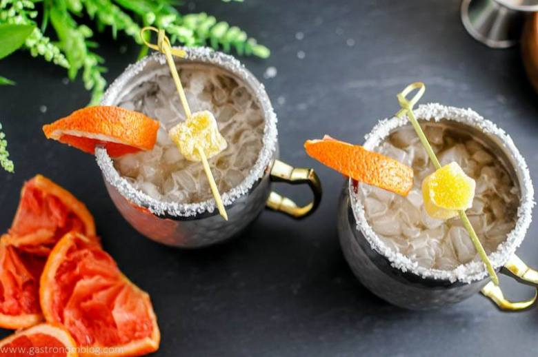 Grapefruit Smoked Salt London Mule in mugs with salt rims, grapefruit slices.