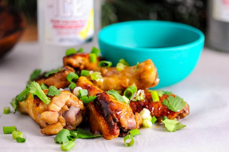 Asian chicken wings glazed in a sauce made from Smirnoff Ice, Brown Sugar, and teriyaki are a great holiday party appetizer!