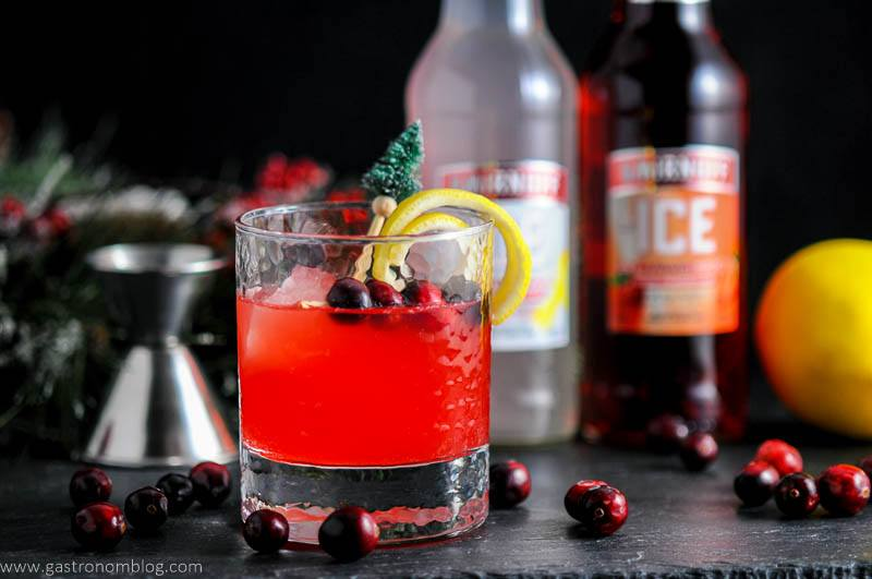 A festively garnished Holiday Berry Sparkler makes for a great cocktail at holiday parties!