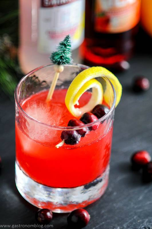 Cranberries and lemon curls garnish our Holiday Berry Sparkler Cocktail.