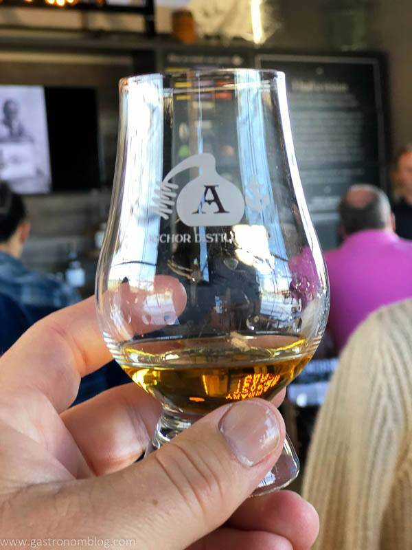 a snifter of whiskey in the Anchor Distilling Tasting room.