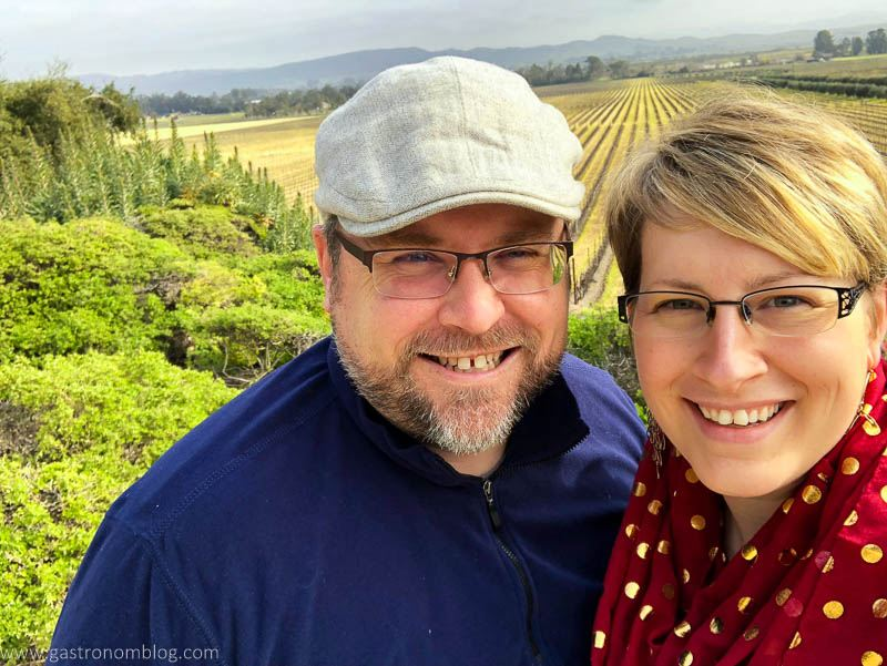 A selfie of a man and woman in front of the Sonoma Valley from the overlook at the Gloria Ferrer Caves and Vineyards in Sonoma California.