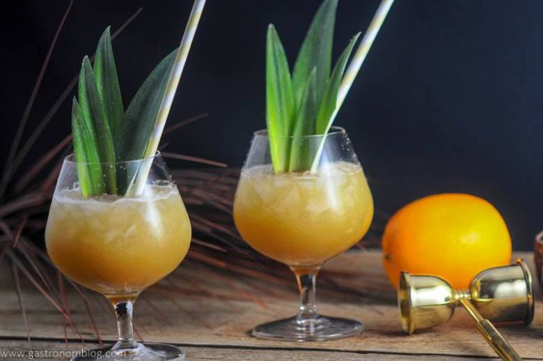 Coconut Rum Painkillers are a great rum and pineapple Tiki Cocktail that is perfect for beating the heat!