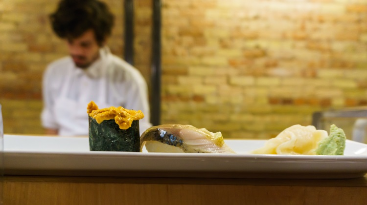 naked fish japanese bistro uni nigiri on sushi bar counter