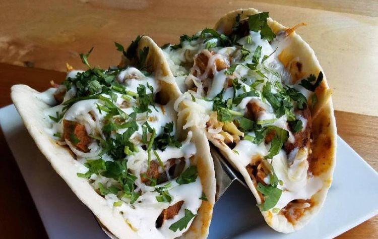 Taqueria 27 - red chile pork tacos with Oaxaca cheese. Credit Taqueria 27
