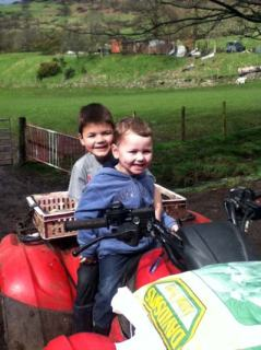 Kids on a quad bike at the local farm.