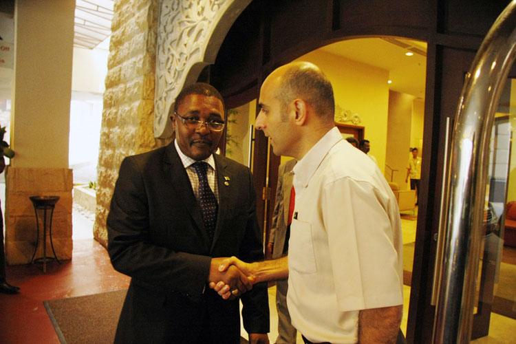 Mr Franck Loison, General Manager of Pullman Putrajaya Lakeside (right) welcoming Hon. Eng. E. Mzembi, Minister of Tourism & Hospitality Industry of Zimbabwe (left)