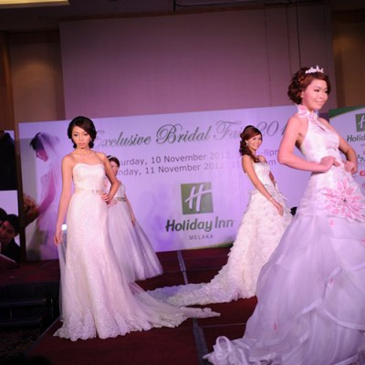 Elegant models strolling down the stage with the latest wedding gown