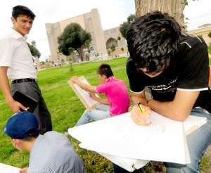 Students drawing the scenery within Bibi Khanum Mosque's inner courtyard