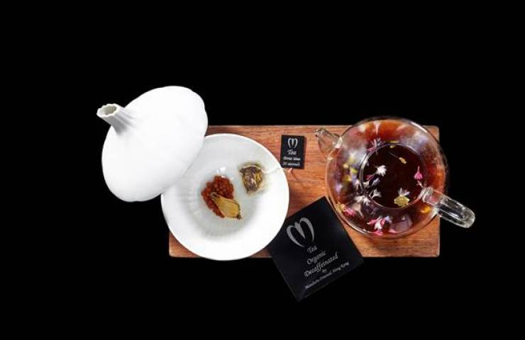 Cathay Pacific Airways has joined with Mandarin Oriental Hotel Group for in-flight dining - Tea (Mushroom, Consomme, Gold, Flowers)