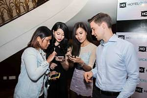 HotelQuickly CEO & Co-Founder,  Tomas Laboutka (far right), explaining the mobile app to guests at the HotelQuickly official launch