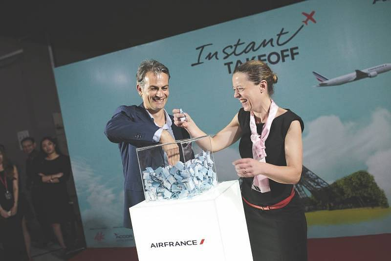 Air France-KLM Commercial Director Matthieu Tetaud Country Manager for Malaysia and Brunei Aude-Lise Combier drawing the lucky winners' tickets