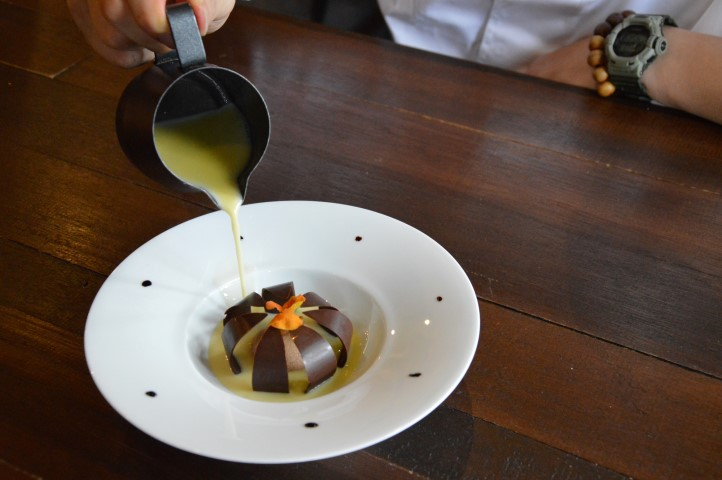 The dish called the Melbourne Pollen has textures of chocolate and pine nuts and blooms upon contact with heated olive oil
